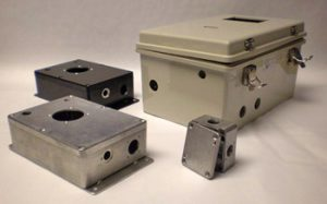 Electronics enclosures with modifications